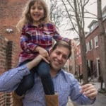 Father carrying daughter in Old City Philadelphia.