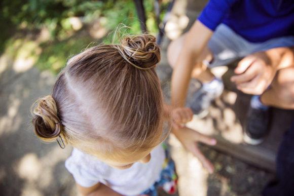Overhead shot of little girl's hair buns.