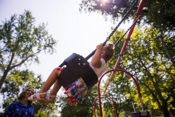Young girl swinging.