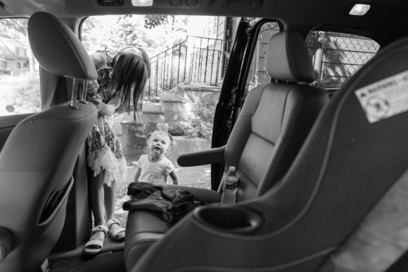 Kids climbing into car.