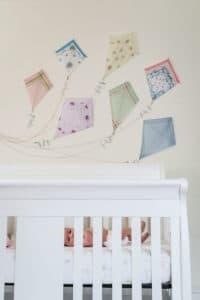 Detail of kite artwork on wall of baby nursery.