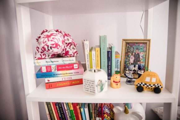 Close up of items on shelf in baby's nursery.