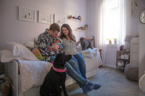 Family and pets in baby's nursery.
